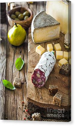 Cheese And Salami Canvas Print by Mythja Photography