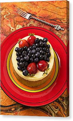 Cheesecake On Red Plate Canvas Print by Garry Gay