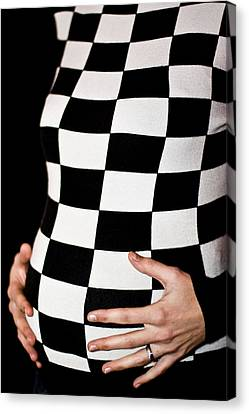 Chequered Pregnancy Canvas Print by Gabor Pozsgai