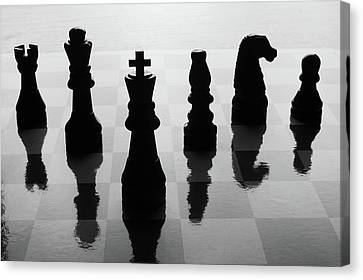 Reflection Canvas Print - Chess Board And Pieces by Jon Schulte