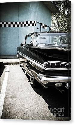 Chevrolet Impala In Front Of American Diner Canvas Print by Perry Van Munster