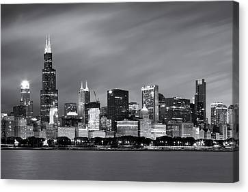 Canvas Print featuring the photograph Chicago Skyline At Night Black And White  by Adam Romanowicz