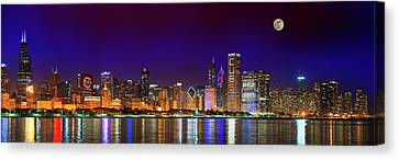 Chicago Skyline With Cubs World Series Lights Night, Moonrise, Lake Michigan, Chicago, Illinois Canvas Print by Panoramic Images