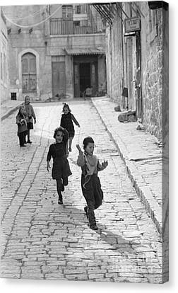 Children Playing In Jerusalem, 1952 Canvas Print by The Harrington Collection