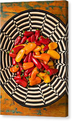 Chili Peppers In Basket  Canvas Print by Garry Gay