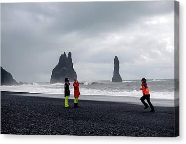 Canvas Print featuring the photograph China's Tourists In Reynisfjara Black Sand Beach, Iceland by Dubi Roman
