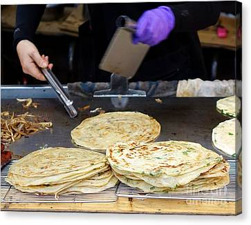 Canvas Print featuring the photograph Chinese Street Vendor Cooks Onion Pancakes by Yali Shi