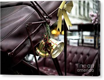 Christmas Bell On The Carriage Canvas Print by John Rizzuto