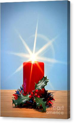 Christmas Candle With Starburst And Holly. Canvas Print by Richard Thomas