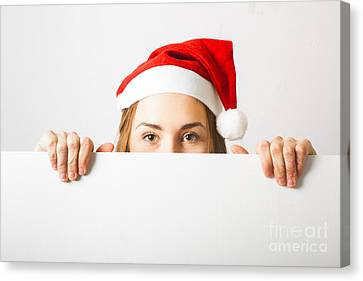 Christmas Elf Holding Empty Advertising Copy Space Canvas Print by Jorgo Photography - Wall Art Gallery