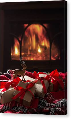 Christmas Gifts By The Fireplace Canvas Print