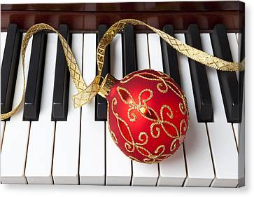 Christmas Ornament On Piano Keys Canvas Print by Garry Gay