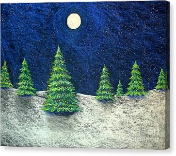 Christmas Trees In The Snow Canvas Print by Nancy Mueller
