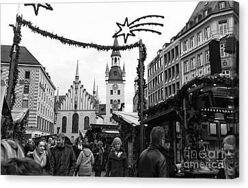 Christmas Walk In Munich Canvas Print by John Rizzuto