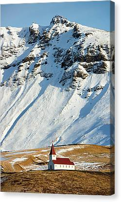 Canvas Print featuring the photograph Church And Mountains In Winter Vik Iceland by Matthias Hauser