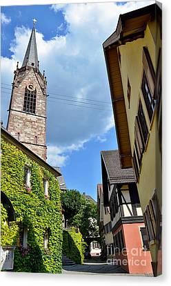 Church Tower Between Houses Canvas Print by Elzbieta Fazel