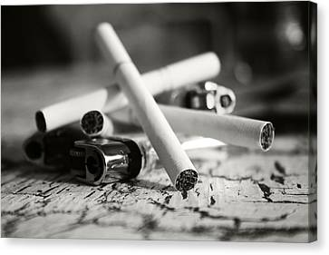 Cigarette And Lighters Canvas Print by Adam LeCroy