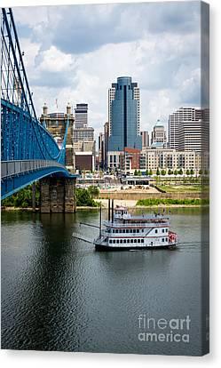 Cincinnati Skyline Riverboat And Bridge Canvas Print by Paul Velgos