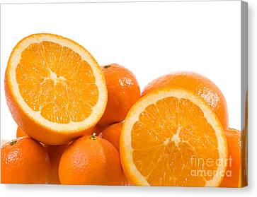 Citrus Fruits Mandarine And Orange On White  Canvas Print by Arletta Cwalina