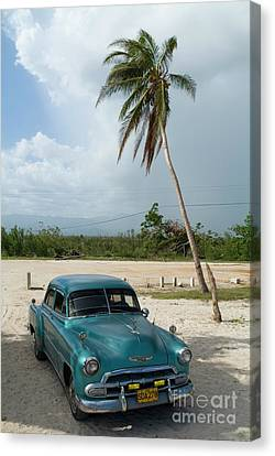 Classic American Car Parked At Ancon Beach Canvas Print by Sami Sarkis