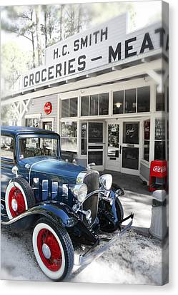 Classic Chevrolet Automobile Parked Outside The Store Canvas Print by Mal Bray