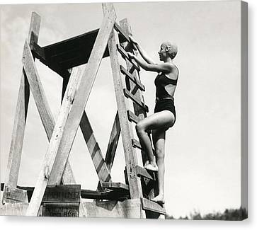 Climbing Up The High Dive Canvas Print by Underwood Archives