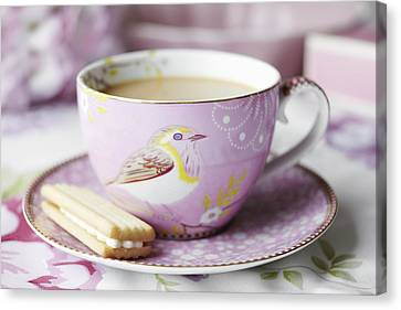 Close Up Of Cup Of Tea And Cookie Canvas Print