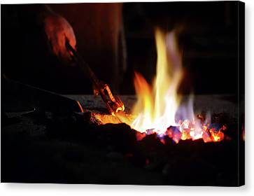 Blacksmith Canvas Print - Close-up Of Hand  Heating Iron In Furnace by Johan Swanepoel