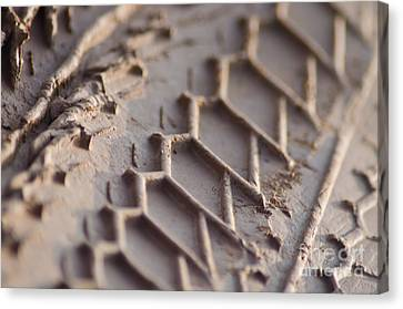 Close Up Of Motorcycle Tread Pattern On Muddy Trail Canvas Print