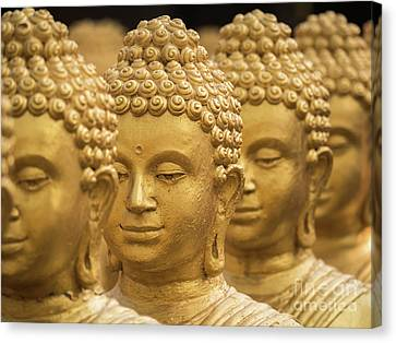 Canvas Print featuring the photograph Close-up On Head Buddha Statue, Soft Focus. by Tosporn Preede