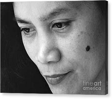 Closeup Of A Filipina Beauty With A Mole On Her Cheek Canvas Print by Jim Fitzpatrick