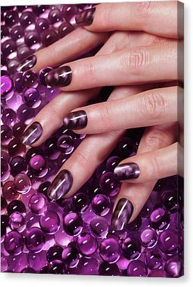 Closeup Of Woman Hands With Purple Nail Polish Canvas Print by Oleksiy Maksymenko