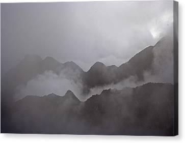 Cloud Shrouded Machu Picchu Canvas Print by Michael Melford
