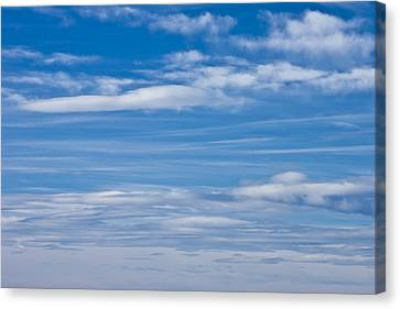 Cloud Streaked Blue Sky Canvas Print by Sandra Foster