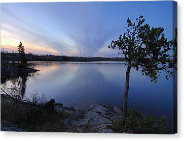 Clouds At Sunset On Seagull Lake Canvas Print by Larry Ricker