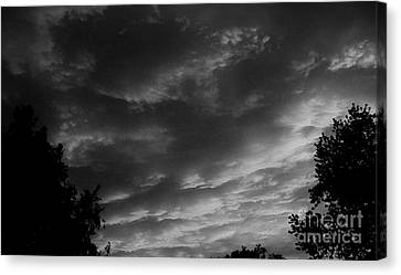 Clouds Before The Storm Canvas Print by Marsha Heiken