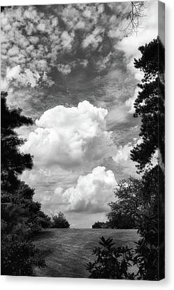 Clouds Illusions Canvas Print by Jessica Jenney