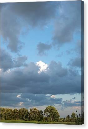 Clouds In A Bright Sky Canvas Print