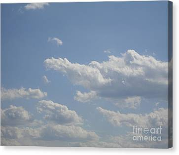 Clouds In The Sky One Canvas Print by Daniel Henning