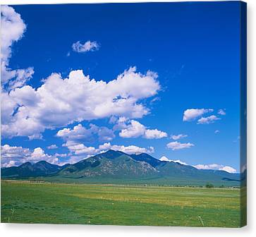 Clouds Over A Mountain Range, Taos Canvas Print by Panoramic Images