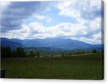 Clouds Over Cades Canvas Print by Laurie Perry