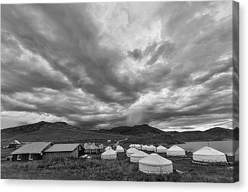 Clouds Over Ger Camp Canvas Print by Hitendra SINKAR