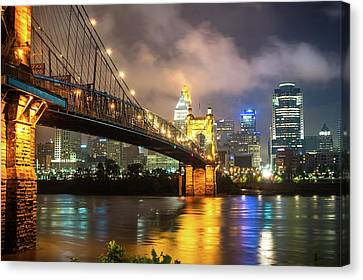 Canvas Print featuring the photograph Clouds Over The Cincinnati Skyline - Night Cityscape by Gregory Ballos