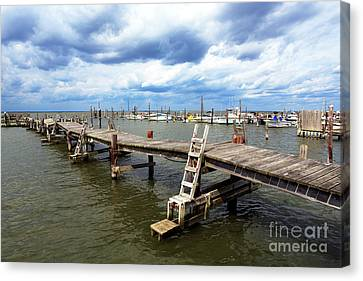 Canvas Print featuring the photograph Clouds Over The Dock by John Rizzuto