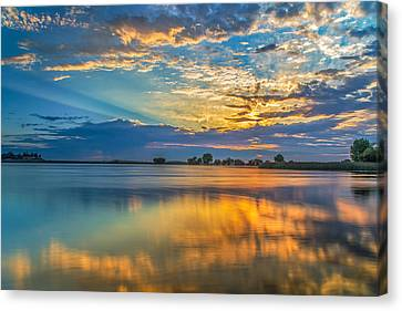 Clouds Reflected At Sunrise Canvas Print by Marc Crumpler