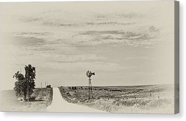 Cloudy Skys And Dirt Roads Canvas Print by Wilma  Birdwell