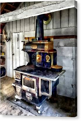 Coal Stove In Kitchen Canvas Print by Susan Savad