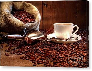 Coffee Cup With Burlap Sack Of Roasted Beans  Canvas Print by Sandra Cunningham
