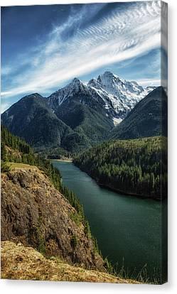 Colonial Peak Towers Over Diablo Lake Canvas Print by Charlie Duncan