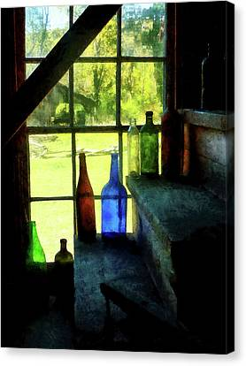 Canvas Print featuring the photograph Colored Bottles On Steps by Susan Savad